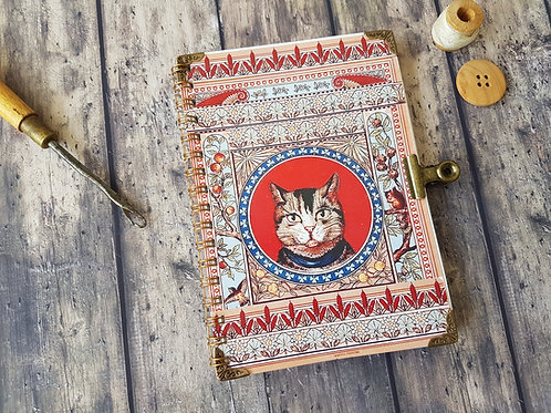 Cat print A6 pocket pad with matching bulldog clasp.