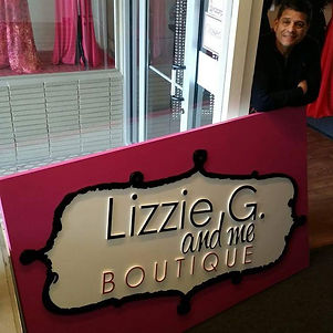 Joel Sandoval Sr with new Lizzie G & me Boutique sign