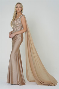 Fitted champagne one shoulder dress with dimensional flower details and a long flowy chiffon train from the shoulder