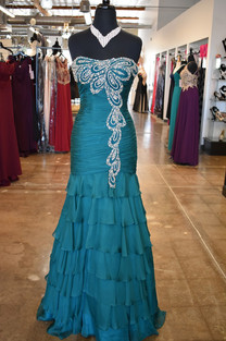 Strapless forest green  mermaid gown by Jovani.  Gorgeous beading on the bodice and down the front side, into lovely chiffon ruffles.  Back zip.   Available sizes: XXS XS  MFSP $800 Was: $450 Now: $299