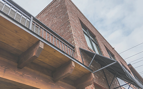 Worman Commercial uses quality materials in all projects.  This commercial and residential building features exposed brick and large energy efficent windows.