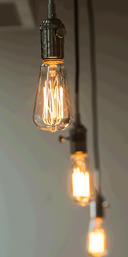 An exposed edison lightbulb featured in a Worman Commercial building.