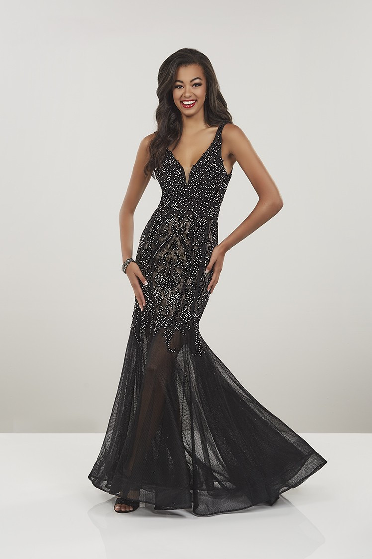 8067934a55 Velvet is cut into a lace design and embroidered on black fishnet for a  stunning look. Sweetheart neckline and low back are complimented by a  mermaid ...