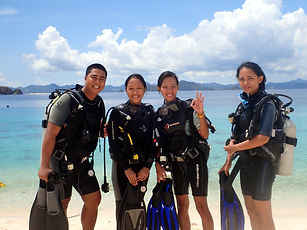 Divemaster Course students in front of turquoise water, Palawan, Philippines