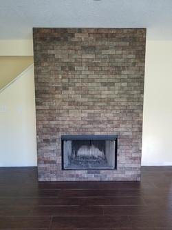 Stone Fireplace w/ Wood-Look Plank