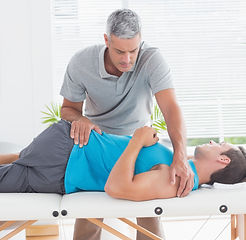 bigstock-physical-therapist-stretching-l
