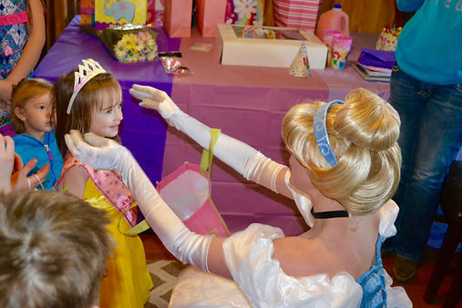Cinderella putting crown on child