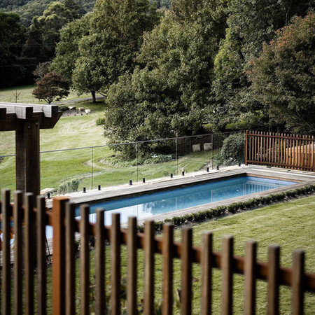 Lap pool with custom timber fence in foreground