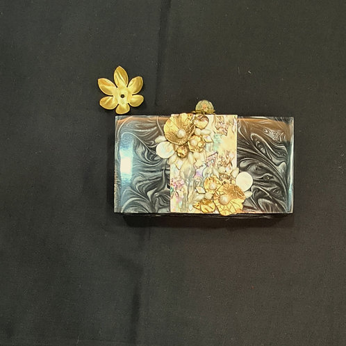 A Handy Clutch Bag In Black With Marble Effect