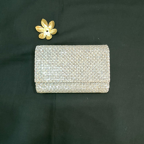 A Handy Clutch bag In Silver With Pearls