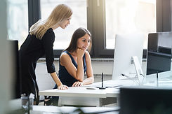 beautiful-women-working-together-office-