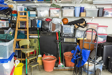 Messy cluttered garage filled with vario