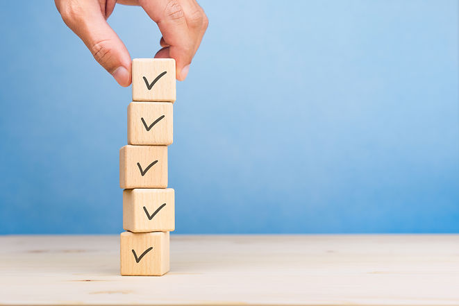 Checklist concept, Check mark on wooden blocks, blue background with copy space.jpg