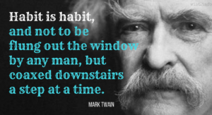Image of Mark Twain with quote text overlaid: Habit is habit and not to be flung out of the window by any man, but coaxed downstairs a step at a time.