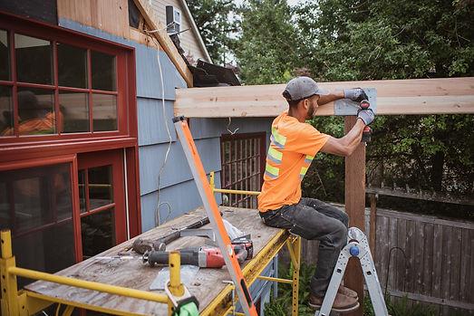Plantrak Decks carpenter in field patio deck Kent Washington
