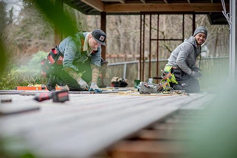 carpenters building a deck Plantrak Decks