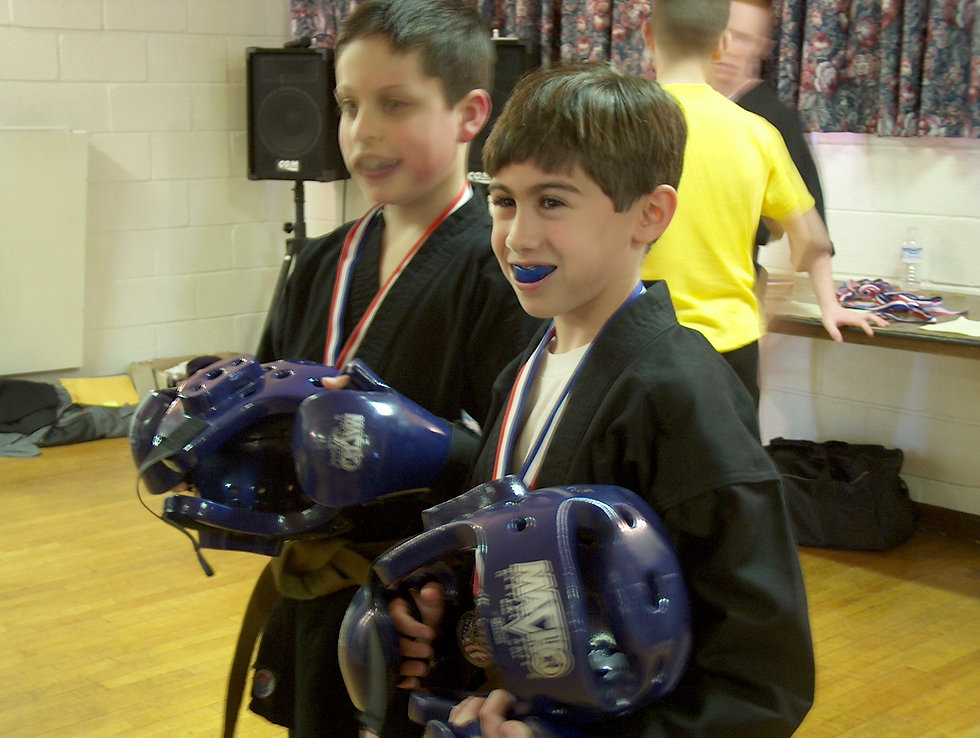 Two young boys in sparring gear training in martial arts