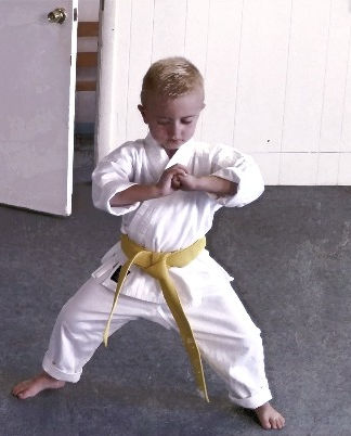 Child in a Meditation house stance at American Karate Studios