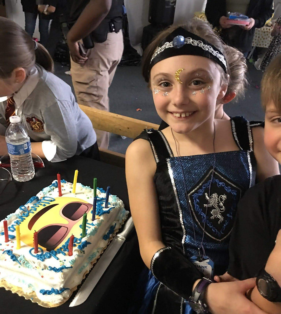 Girl smiling while hugging brother at her birthday party
