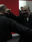 Martial Arts instructor demonstrating proper way to apply self defence technique