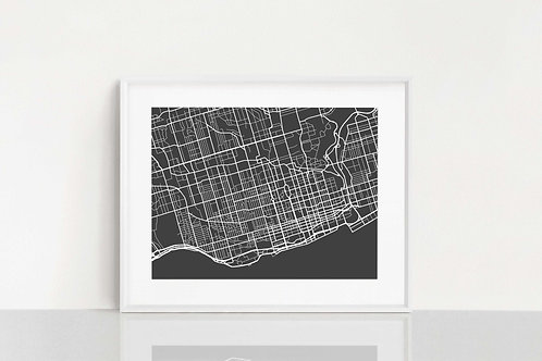 Hand cut paper map of Toronto on table