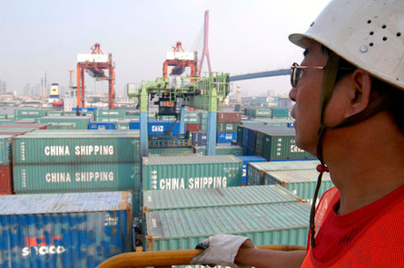 A worker overviewing the China Shipping Terminal in Pudong, Shanghai, China.
