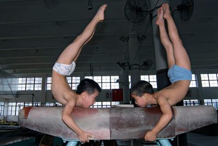 Boys training gymnastics at the Hongkou Youth Sports School, Shanghai, China.