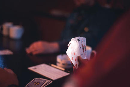 Playing cards in the boat's mess, Grömitz Yacht harbour, Germany.
