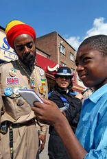 Member of the Haile Selassie I Peace Foundation and the West Midlands Police on the beat, Handsworth, Birmingham.