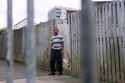Boy on a council estate, Maypole, Birmingham.