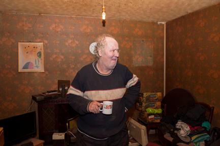 A retired single man in his run down council bungalow, Maypole, Birmingham.