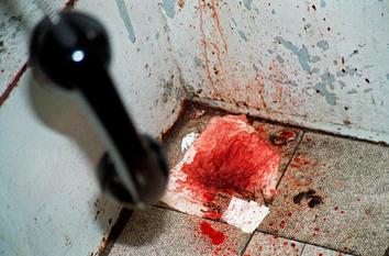 Blood spattered telephone box, Essen, Germany.