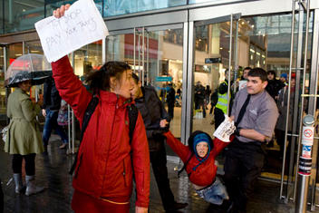 UK Uncut activists get dragged out of the Birmingham Bullring by security staff after an attempting a sit in at Topshop, owned by Sir Philip Green, which they say is avoiding tax.