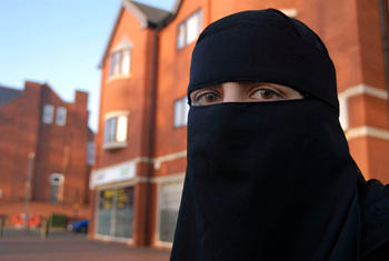 A young Muslim woman wearing Niqab and coloured contact lenses, Stratford Road, Birmingham.