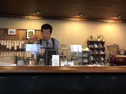 Man making coffee in a traditional coffee house, Kyoto, Japan.