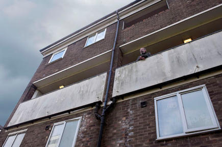 Robert, outside his council flat in Ladywood, Birmingham. He is opposing the bedroom tax.