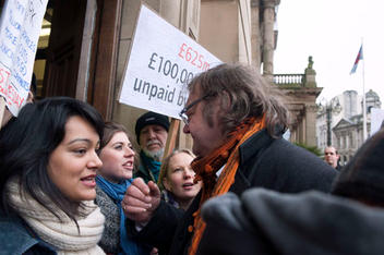 Lib Dem councillor Jerry Evans trying to enter council meeting as protesters blockade the entrances to the Birmingham Council House to prevent councillors to enter for their budget meeting as the Labour run council plans to vote for £102m cuts.