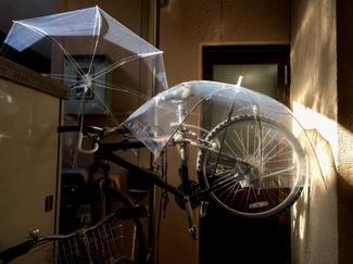 Bicycles and umbrellas in doorway, Kyoto, Japan.