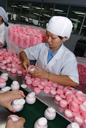 Women working at an assembly line at Jahwa Cosmetics factory, Shanghai, China.