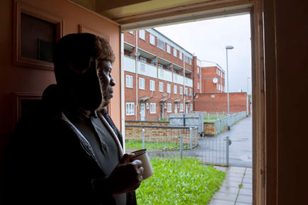 Thandi in his council flat in Highgate, Birmingham. He was asked to pay bedroom tax for one room, which would take him into debt.