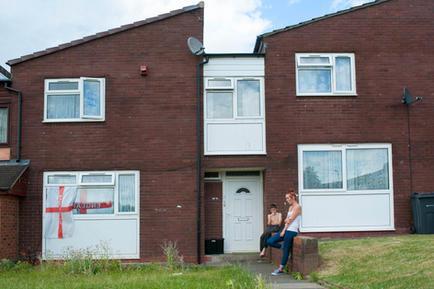 Youth outside their home, Druids Heath, Birmingham.
