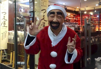 Shopkeeper dressed as father Christmas, Kyoto, Japan.