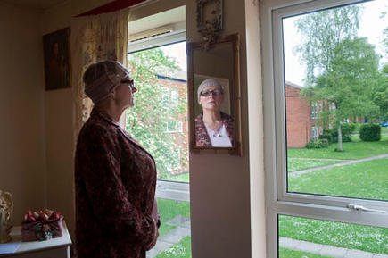 Maggie, in her council flat in Moseley, Birmingham. She was asked to pay bedroom tax for one room, which she can't pay.