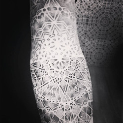 Dotwork geometric mandala arm tattoo