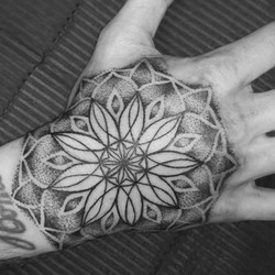 Hand mandala tattoo in dotwork