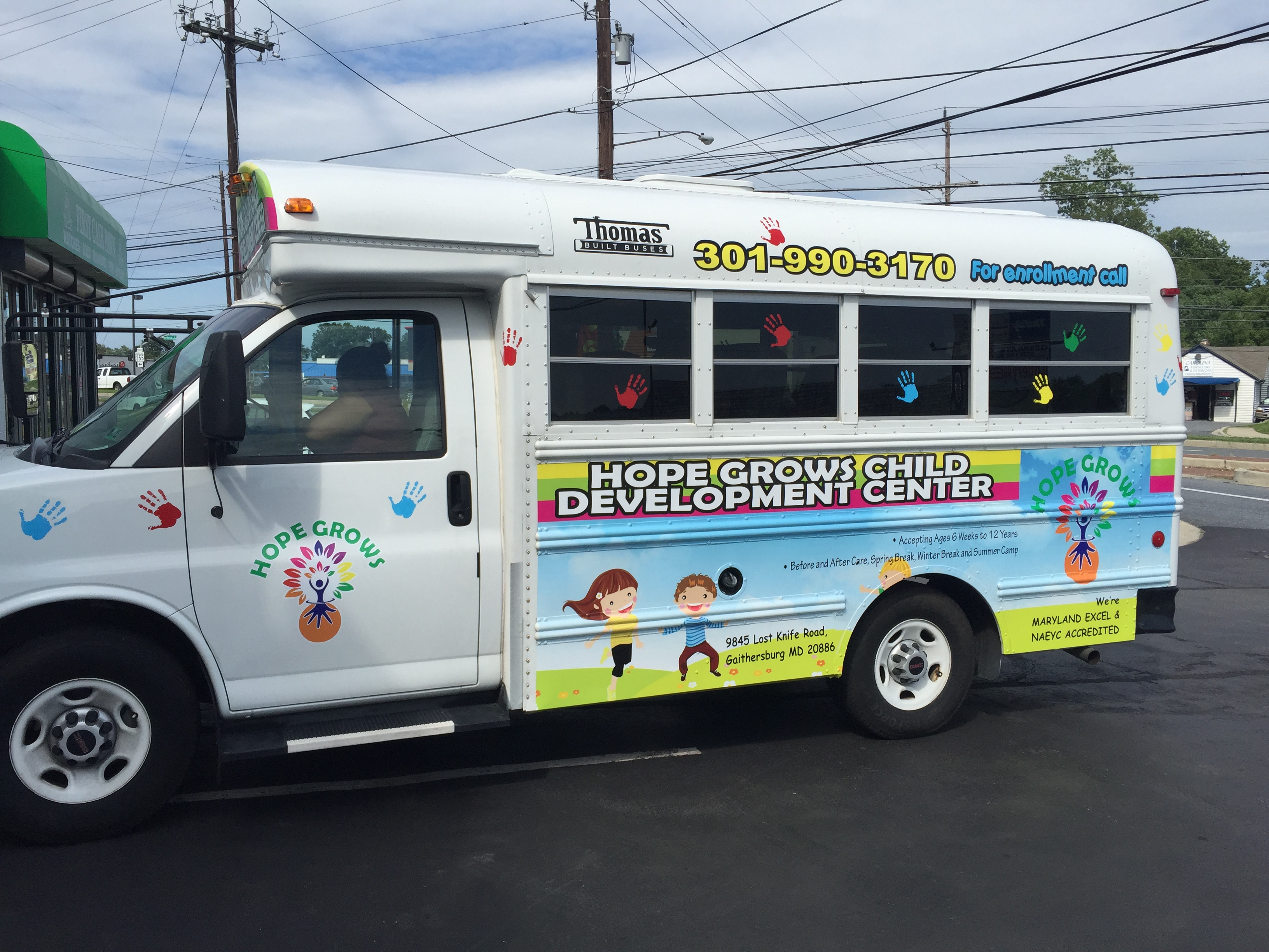 bus wrap | Signs in Rockville