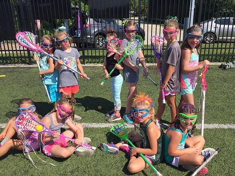 Girls having fun a summer lacrosse camp