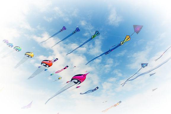 Kites%20Flying%20in%20Cloudy%20Sky_edite