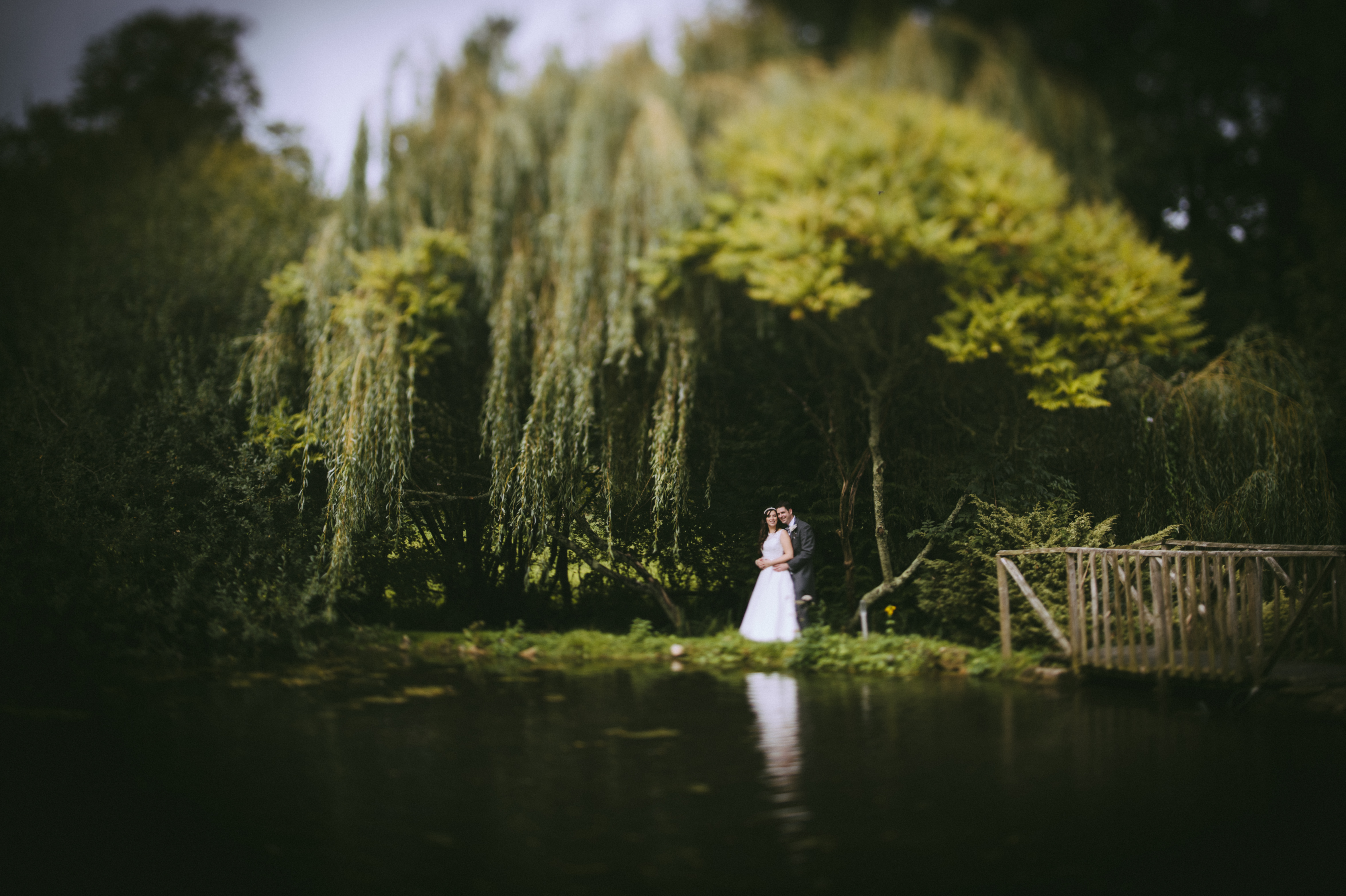 wedding photographers devon bride groom lake.jpg