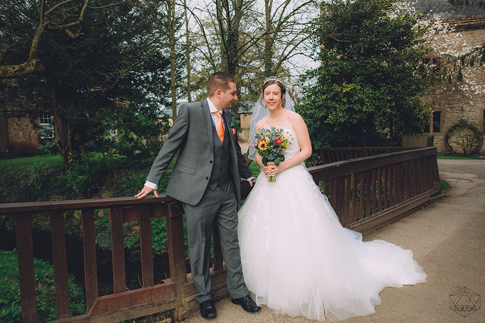 wedding photographers devon bride and groom on bridge.jpg